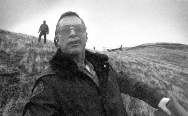 Kern County Sheriff's Sgt.  Drew Patrick shoves me to the ground while covering a plane crash on Feb. 6, 1990.