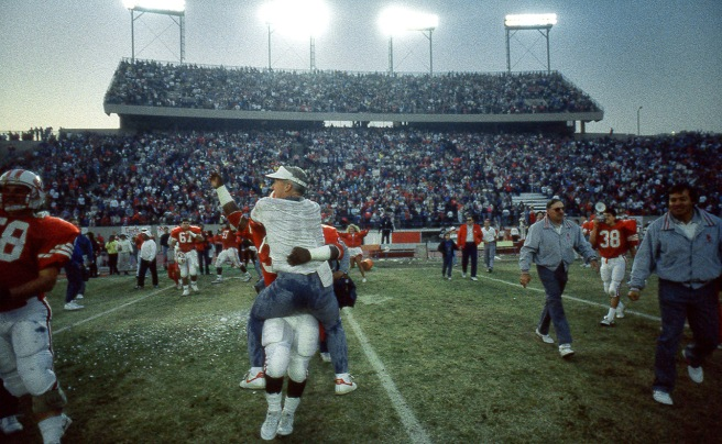 Bakersfield College coach Carl Bowser, his team and 18,237 fans celebrate the victory over Fullerton College for the 1988 national championship. I believe this is a previously unpublished photo.