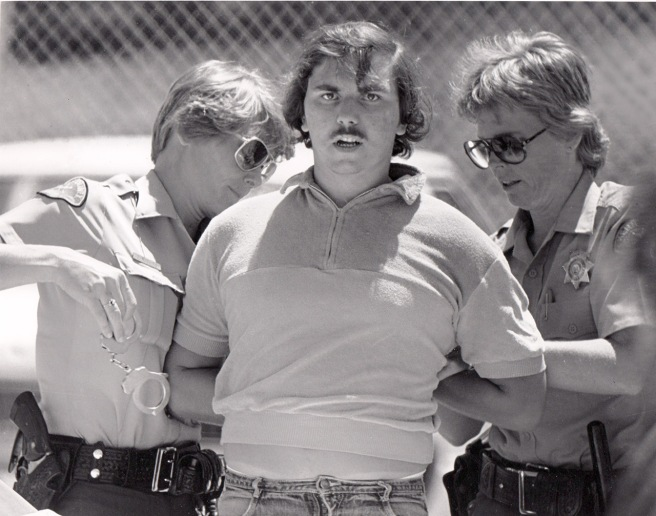 This is me being arrested on June 14, 1981, after photographing the arrest of Daniel Dixon at the Lake Ming boat drags. Dixon was a disabled race worker who they mistook for being drunk. This was the first of two on-the-job arrests in my career. Felix Adamo took the picture, and he would have been arrested, too, if they had seen him.