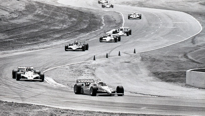 Turn 6 at Riverside was the best place on the track to shoot, so long as you weren't wearing a yellow shirt! That's Rick Mears leading the way through the turn.