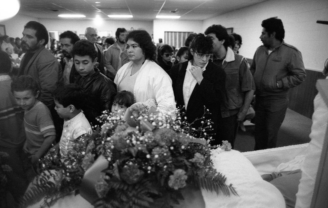 Mourners file past Mario Bravo's casket on December 1, 1987.