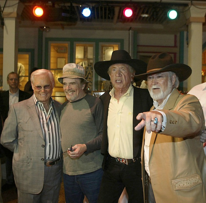 Earlier in the evening, I shot this photo. George Jones, Merle Haggard, Buck Owens and the statude designer, Bill Raines, pose for photos inside the Crystal Palace before the statue unveilings.