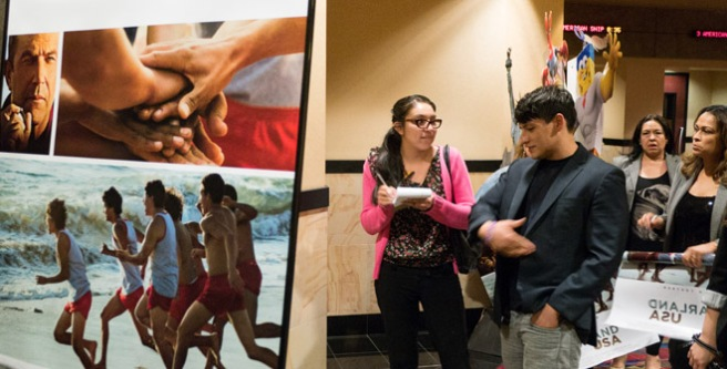 "Carlos Pratts, who had a major role as McFarland High runner Thomas Valles, is interviewed by Bakersfield College Renegade Rip editor Elizabeth Castillo at the Bakersfield sneak peak of ""McFarland USA."""