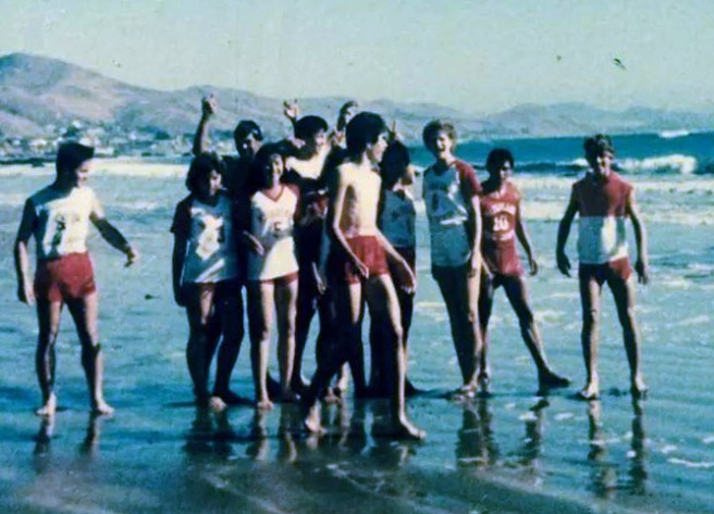 In this photo provided by Flora Diaz, the niece of Sylvia Diaz, one of the two runners killed in the 1986 practice accident, the 1985 McFarland boys and girls team enjoy the beach at Cayucos.