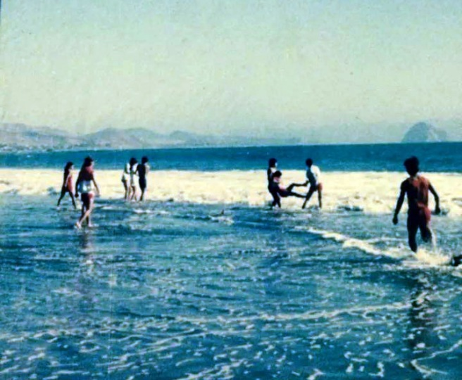In this photo from the album of Sylvia Diaz and shot by her brother, Raul Diaz, the McFarland boys and girls cross country team plays on the beach at Cayucos after coach Jim White took them there in 1985.