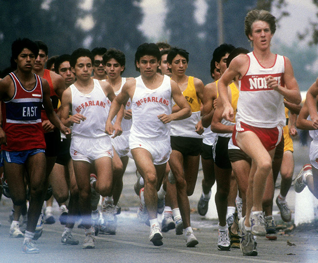 This photo by Henry Barrios is from the Kern Invitational in October 1987. Thomas Valles runs in the center and Johnny Samaniego to his right. Danny Diaz is behind them.