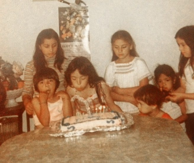 Herlinda at my sister, Corina's birthday party. Corina is blowing out the candles, Sandra is to her right and Herlinda is to her left in the white blouse with her arms crossed. Photo courtesy Sandra Gonzalez.