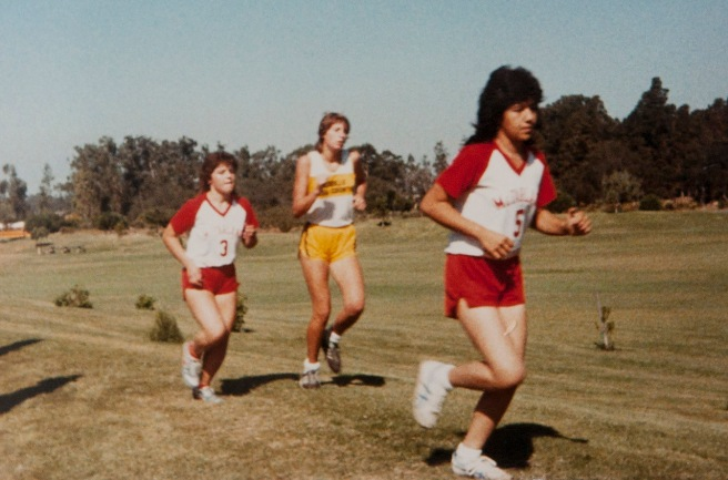 In this photo by Raul Diaz, Sylvia Diaz (3) and teammate Magda Saragoza run in a race in 1985. Photo courtesy Flora Diaz and Raul Diaz
