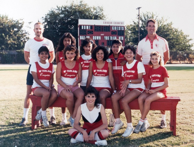 The 1986 McFarland High girls cross country team. Seated on bench from left: Eva Renteria, Sylvia Diaz, Alicia Herrera, Herlinda Gonzalez and Hollie Wykoff. Standing, from left: coach Gary Pierson, Norma Torres, Norma Lopez, Delfina Herrera and coach Jim White. Dolores Plata is sitting on the grass. She was on the 1985 team and became a cheerleader in 1986, but her teammates wanted her in this photo.