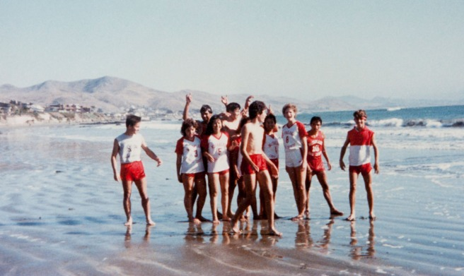 In this photo likely shot by a teammate with Raul Diaz's camera, the McFarland boys and girls cross country teams pose on the beach at Cayucos after coach Jim White made and impromptu stop following the Santa Maria Invitational in 1985. Raul is at the left, his sister Sylvia next to him. Photo courtesy of Sylvia Diaz and Raul Diaz