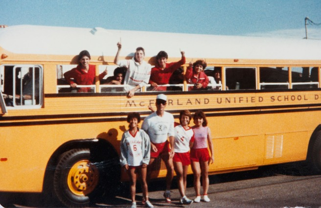 "The team with coach Jim White on the day of the impromptu trip to the beach. Silvia is in the pink shirt. Dolores Plata Rodriguez says the bus trips were the most fun of her cross country experience. Now, nearly 30 years later, Norma Lopez Takahashi gives a little taste of what they were like: ""The movie made the boys look so tough. Heck, we girls could have beat them up,"" she says, delivering a good-natured salvo to her former teammates. Photo courtesy Flora Diaz and Raul Diaz"