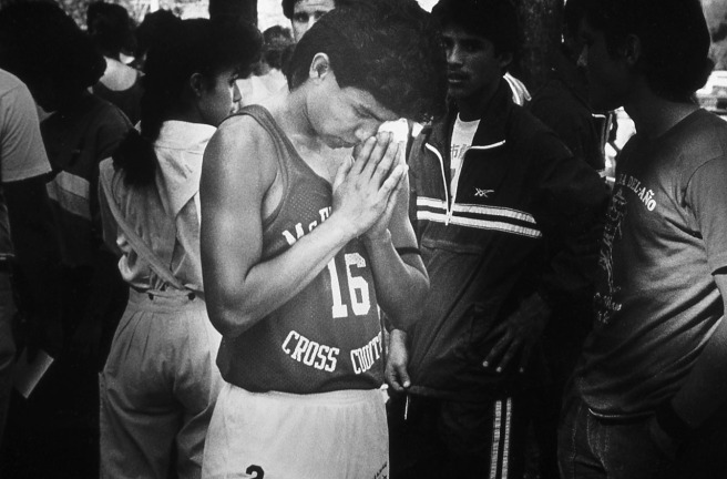 At the Kern Invitational on November 1, 1986, Thomas Valles prays before the start of the boys race. This photo ran in The Californian the next day.