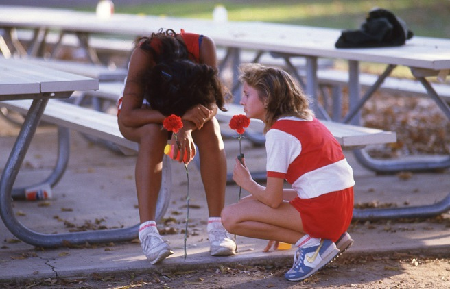 The McFarland girls ran in the CIF Central Section South Area meet at Hart Park on November 13, 1986, two and a half weeks after the accident that claimed teammates Sylvia Diaz and Herlinda Gonzalez. This is Norma Torres and Hollie Wykoff (right) after the race. Wykoff was one of the runners who witnessed the accident.