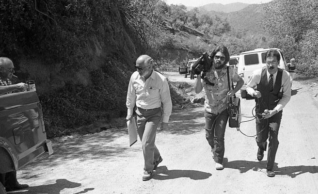 KERO-TV bakersfield reporter Carl Schweitzer and cameraman Rob Bishop follow defense attorney Timothy Lemucchi at the murder scene where William Robert Tyack shot and killed two homosexual men near Glennville California. They were among the media on hand the day the trial was moved to the scene.
