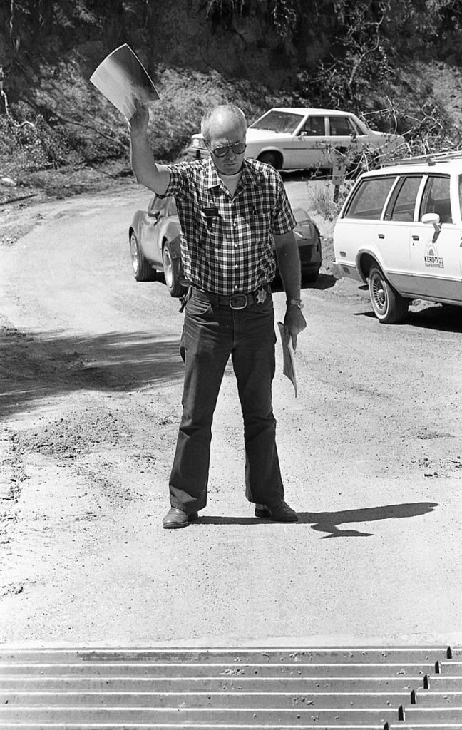 Kern County sheriff's technical investigator Tom Jones testifying at the location where two gay men, Jack Blankenship and Sidney Wooster, were shot and killed during a confrontation with William Robert Tyack near Glennville, California in August, 1981.