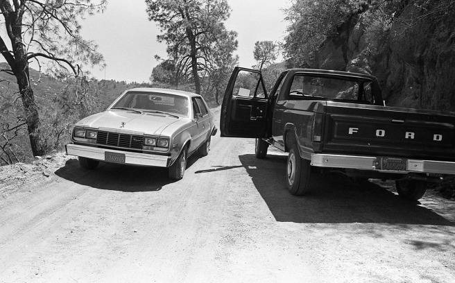 Two vehicles put in place for most likely a visual recreation of their position on the road outside Glennville, California during the shooting deaths of Jack Blankenship and Sidney Wooster by William Robert Tyack.