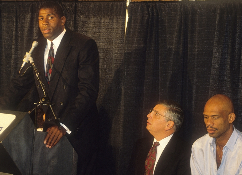 John Harte / The Bakersfield Californian On November 7, 1991, Magic Johnson shocked the world with his announcement that he was HIV positive and, still in the prime of his career, retiring from the Lakers. In this frame is NBA commissioner David Stern, Kareem Abdul-Jabbar and Johnson's agent, Lon Rosen. Californian reporter Brad Turner and photographer John Harte covered the announcement, racing to the Great Western Forum in Inglewood and entering through a kitchen when the main entrance to the press area was inaccessible due to a throng of media and fans who descended to the scene.